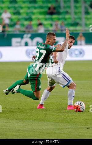 Budapest, Hungary. 19th September, 2015. Roland Varga of Ferencvaros (l) is pulled down by Balint Borbely of B'csaba - Stock Photo