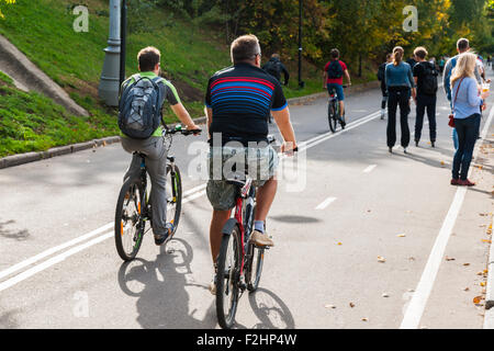 Moscow, Russia. Saturday, Sept. 19, 2015. Warm weekend. It is comfortable to be outdoors. Unidentified bikers go - Stock Photo