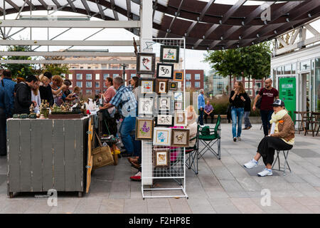 Moscow, Russia. Saturday, Sept. 19, 2015. Warm weekend. It is comfortable to be outdoors. Selling arts and crafts - Stock Photo