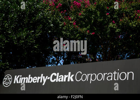 A logo sign outside of the headquarters of the Kimberly-Clark Corporation in Irving, Texas on September 13, 2015. - Stock Photo