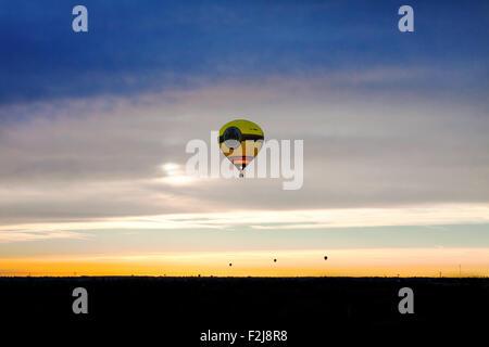 Ferrara, Italy - September 19, 2015: Many hot-air balloons during flight at dawn at 'Ferrara Balloons festival 2015' - Stock Photo