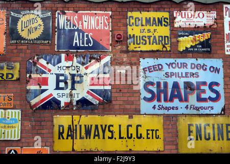 Vintage enamel advertising signs at Bygone Times antiques centre, Eccleston, Chorley, , Lancashire, England UK - Stock Photo
