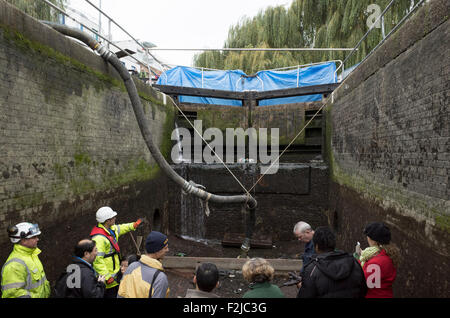 Renovation work on the Camden Lock gates showing the drained lock on the Regent's Canal in London - Stock Photo