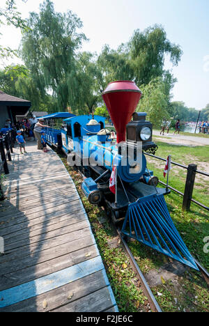 The well-known Centreville miniature train ride at Centreville amusement park on the Toronto Islands. Toronto Ontario - Stock Photo