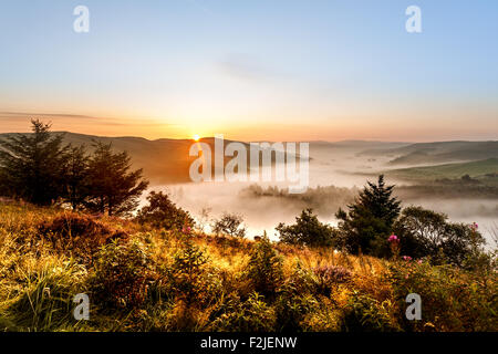 Landscape of a Sunrise over the Cambrian mountains with a mist covered valley below at Ceredigion Wales UK - Stock Photo