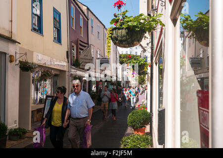 A narrow street full of tourists in Dartmouth, Devon, England - Stock Photo