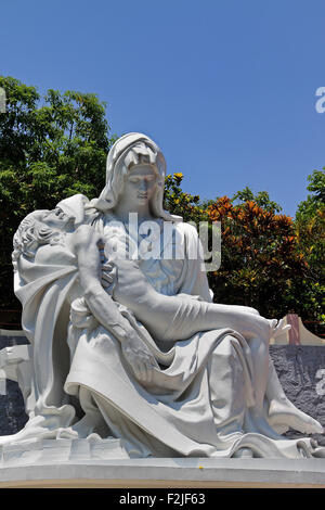 The Pietà is a subject in Christian art depicting the Virgin Mary cradling the dead body of Jesus. - Stock Photo