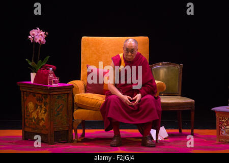 London, UK. 20th September, 2015. His Holiness the 14th Dalai Lama talks on the stage of the London Coliseum about - Stock Photo