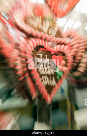 'Ich liebe dich' means I love you on a gingerbread heart on a christmas market, zoomed and blurred, in Germany Europe - Stock Photo