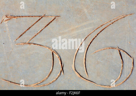 Photo of Numbers thirty-six etched in stone - Stock Photo