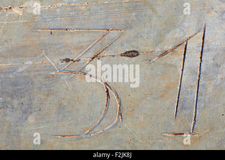 Photo of Numbers thirty-one etched in stone - Stock Photo