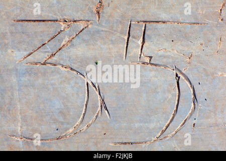 Photo of Numbers thirty-five etched in stone - Stock Photo