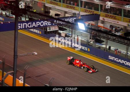 Singapore. 20th September, 2015. Sebastian Vettel of team Scuderia Ferrari gestures as he wins the Singapore Street - Stock Photo