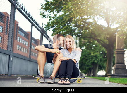 Man caressing woman in a charming way, big city couple - Stock Photo