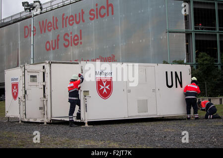 Cologne, Germany. 20th Sep, 2015. Paramedics of the Maltese Emergency Services set up a container next to the airport - Stock Photo