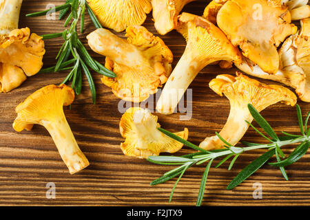 Yellow chanterelles on wooden table - Stock Photo