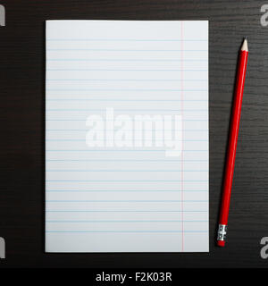 Blank white paper and pencil on wooden desk - Stock Photo