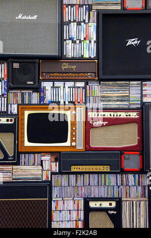 Wall of vintage and retro cds, vinyls, tv, amplifiers, VHS and audio tapes - Stock Photo