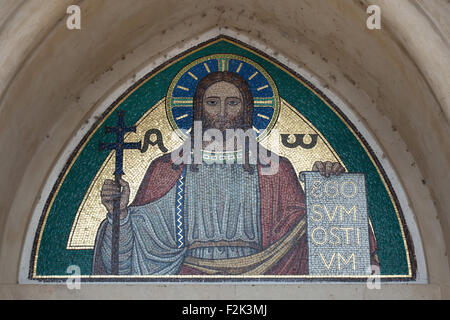 Jesus Christ. Mosaic by the Beuron Art School from the 1910s over the main entrance to the Church of Blessed Virgin - Stock Photo