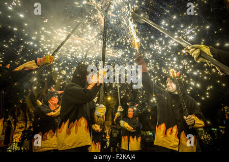 Barcelona, Catalonia, Spain. 20th Sep, 2015. The correfocs, dancing devils, gather to enlighten their fire crackers - Stock Photo
