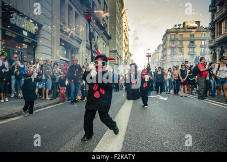 Barcelona, Catalonia, Spain. 20th Sep, 2015. A child in a devil costume runs with his fireworks during the 'correfocs' fire-runs during Barcelona's city festival 'La Merce' 2015 Credit:  Matthias Oesterle/ZUMA Wire/Alamy Live News