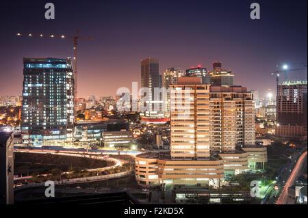 A baixa da cidade de Luanda ao cair da noite. - Stock Photo