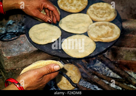 Indian women cooking in the village - Stock Photo