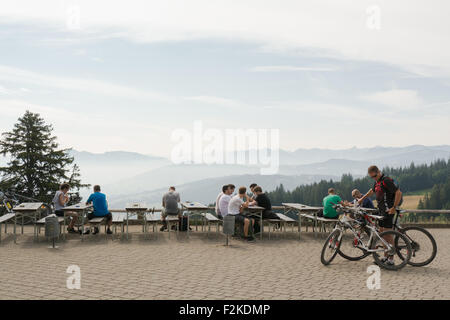 Alpine peaks viewed through layers of mist from a viewing platform on the Pfaender mountain, Bregenz, Austria - Stock Photo