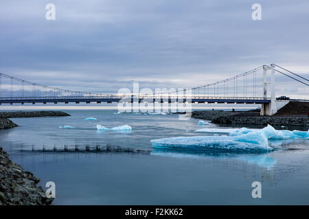 Jokulsarlon bridge, large glacial lake in southeast Iceland - Stock Photo