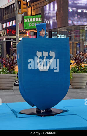 MTV filming a holiday segment with a giant Channukah dreidel. In Times Square, New York City. - Stock Photo