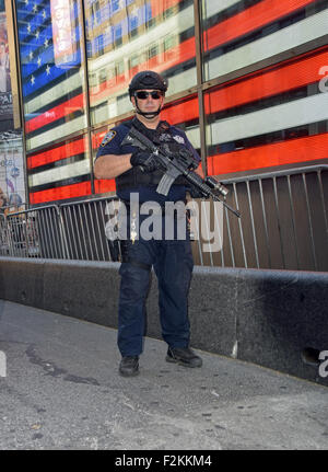 Portrait of a policeman from the NYPD Emergency Services unit patrolling in Times Square, Manhattan, New York City. - Stock Photo