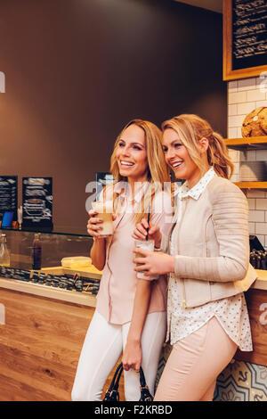 Two female friends with Latte Macchiato - Stock Photo