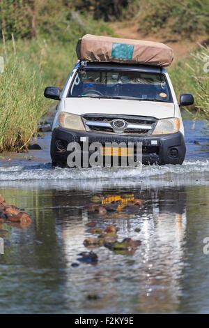 Zimbabwe, Masvingo, Gonarezhou National Park, off-road vehicle crossing Runde River - Stock Photo
