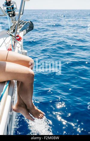 Spain, Mallorca, Woman sitting on sailing boat - Stock Photo