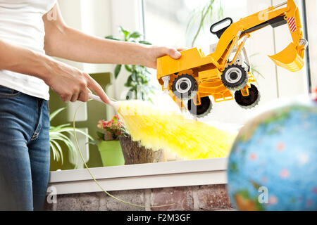 Woman cleansing windowsill in children's room - Stock Photo
