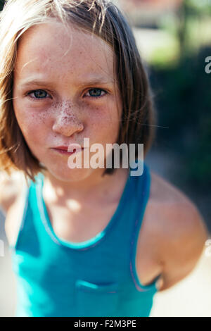 Portrait of girl with brown hair and freckles - Stock Photo