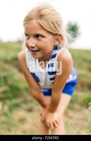Portrait of blond girl watching something - Stock Photo