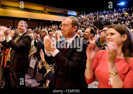 Bournemouth, UK. 21st Sep, 2015. Leader Tim Farron claps following Former Deputy Prime Minister Nick Clegg's speech - Stock Photo
