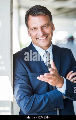 Mature businessman smiling confidently, portrait - Stock Photo