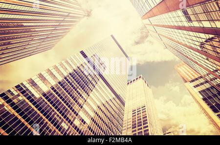Retro stylized photo of skyscrapers in Manhattan at sunset, New York City, USA. - Stock Photo