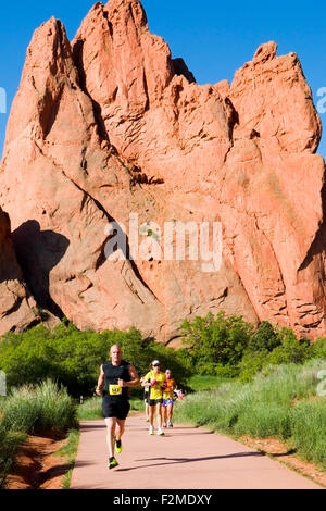 Runners, spectators and volunteers participating in the 39th annual running of the Garden of the Gods Ten Mile Run - Stock Photo
