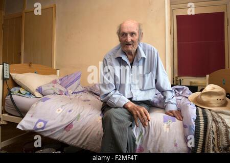 Housebound old age pensioner, living alone in social housing, Alderton, Suffolk, UK. - Stock Photo