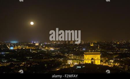 Paris, Moonrise over the Arc de Tromp and City Skyline, France - Stock Photo