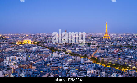 Paris City Skyline, Arc de Triomphe and the Eiffel Tower, viewed over rooftops, Paris, France, Europe - Stock Photo