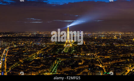 Elevated night view of the Eiffel Tower, city skyline and La Defence skyscrapper district in the distance, Paris, - Stock Photo