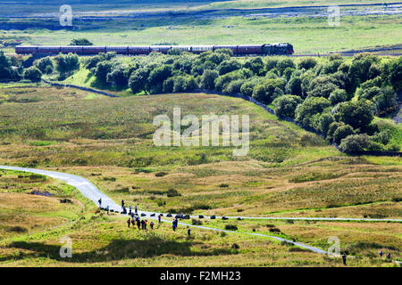 Crowds Watching The Fellsman Hauled by 46115 Scots Guardsman at Ribblehead Yorkshire Dales North Yorkshire England - Stock Photo