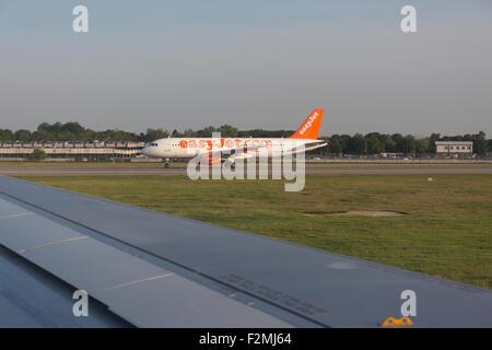 Easyjet plane preparing for take off at London Gatwick airport, Surrey, UK - Stock Photo