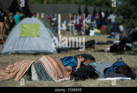 Opatovac, Croatia. 21st Sep, 2015. Refugees rest in a tent camp near Opatovac, Croatia, 21 September 2015. Photo: - Stock Photo