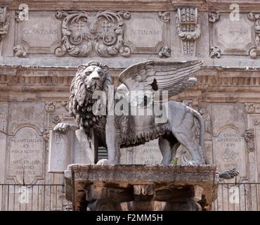 Statue of Lion of St Mark and Pallazo Maffei at Piazza delle Erbe in Verona Italy - Stock Photo