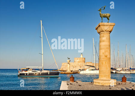 The entrance with the deers of the old port of Rhodes, Greece - Stock Photo